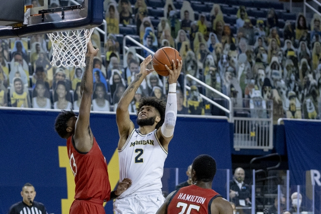 Michigan Forward Isaiah Livers (2) Gets by the Maryland Defender for a Lay-up.