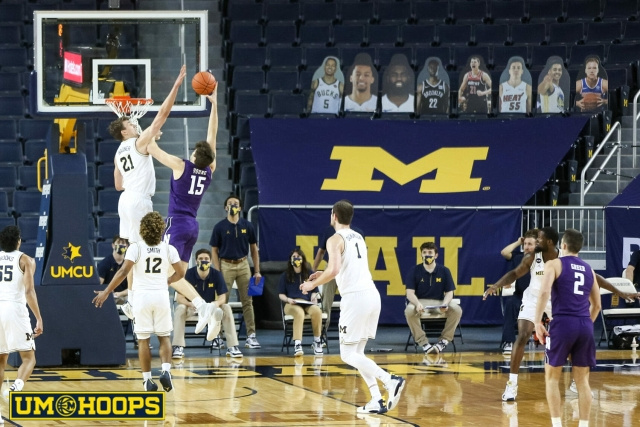 Michigan Guard Franz Wagner (21) Blocks a Lay-up by the Northwestern Player.