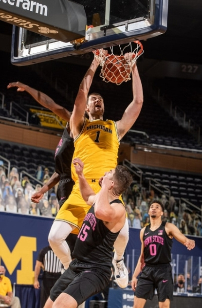 Michigan Center Hunter Dickinson Gets by the Penn State Defenders for a Dunk.