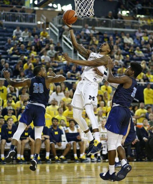 Michigan Guard Charles Matthews (1) Gets to the Basket.