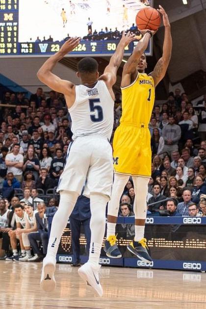 Michigan Guard Charles Matthews (1) Takes a Jump Shot Over the Villanova Defender.