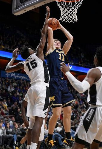 Michigan Forward Ignas Brazdeikis (13) Gets by the Providence Defender for the Score.