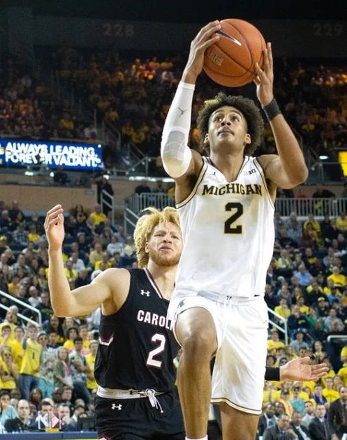Michigan Guard Jordan Poole (2) Gets by the South Carolina Defender for a Score.