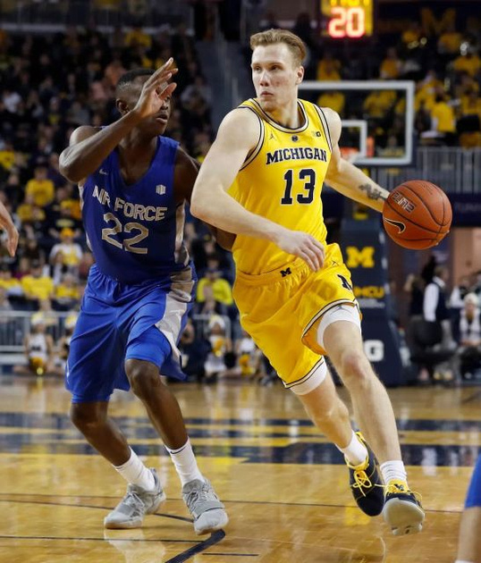 Michigan Forward Ignas Brazdeikis (13) Gets by the Air Force Defender.