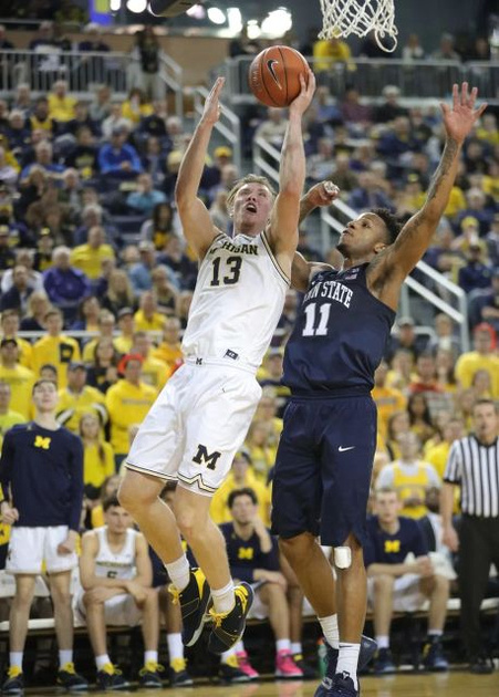 Michigan Forward Ignas Brazdeikis (13) Gets by the Penn State Defender for a Lay-up.