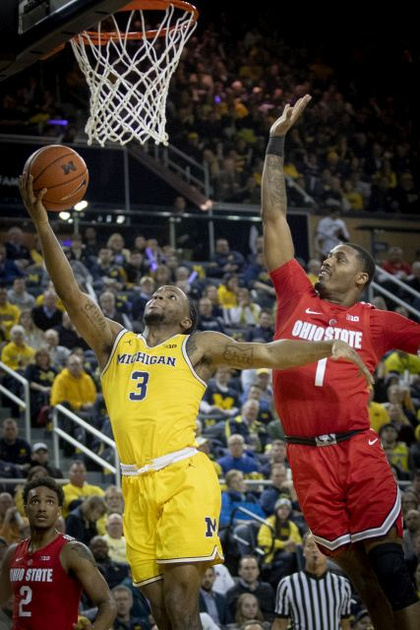 Michigan Guard Zavier Simpson (3) Gets by the Ohio State Defender for a Lay-up.