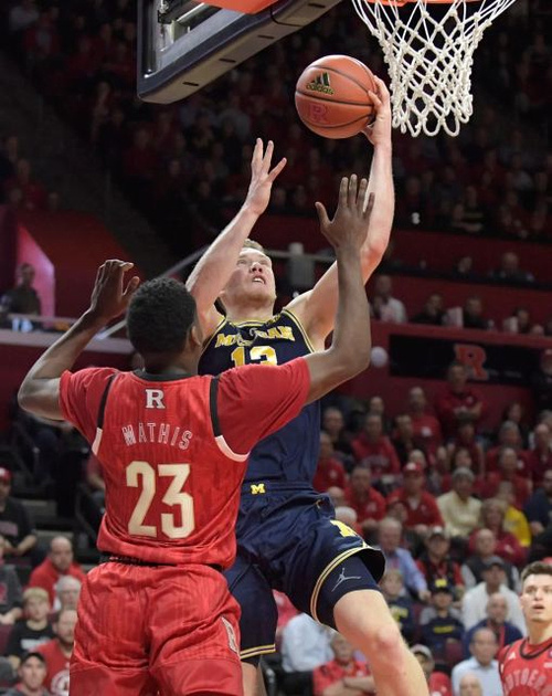 Michigan Forward Ignas Brazdeikis (13) Gets by the Rutgers Defender for a Lay-up.