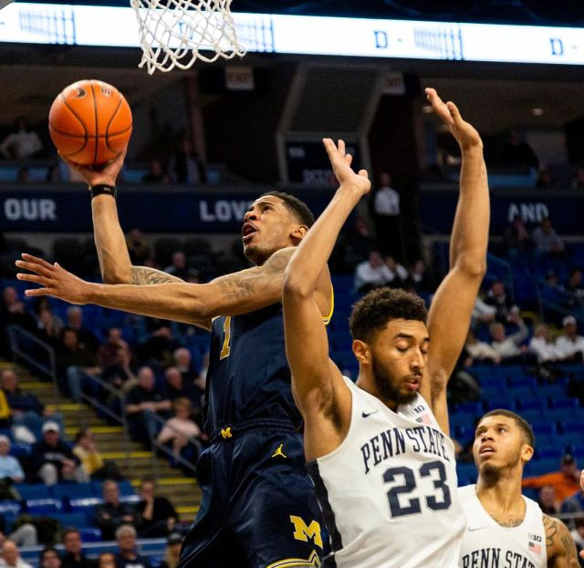 Michigan Guard Charles Matthews (1) Gets by 2 Penn State Defenders for a Lay-up.