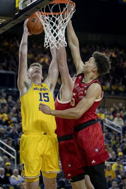 Michigan Center Jon Teske (15) Gets by Two Nebraska Defenders for a Dunk.
