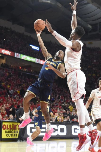 Michigan Guard Zavier Simpson (3) Scores Over the Maryland Defender.