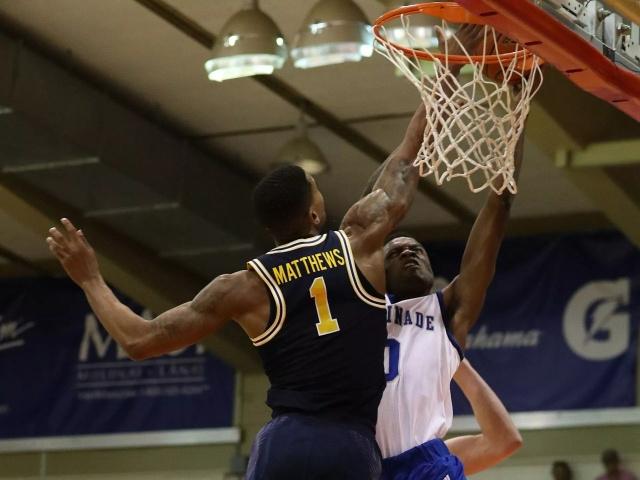 Michigan Guard Charles Matthews (1) Blocks a Chaminade Basket.