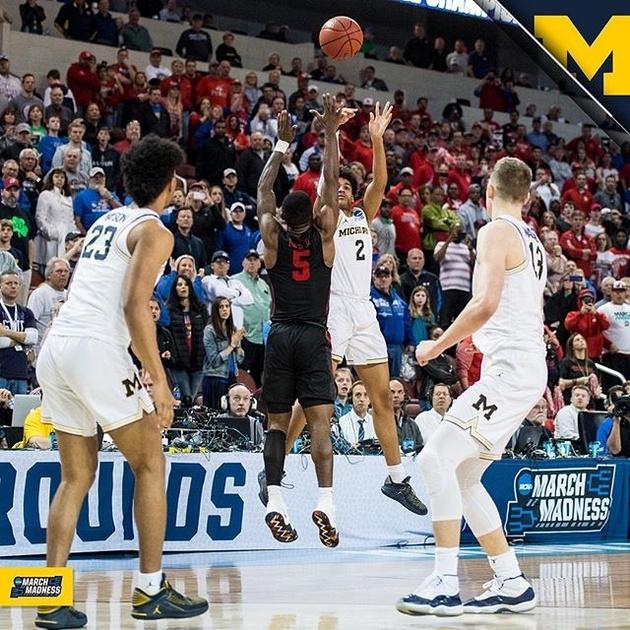 Michigan Guard Jordan Poole (2) Shoots the Game Winning Three Pointer.