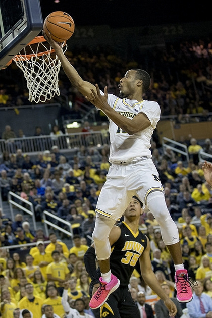 Michigan Guard Muhammad-Ali Abdur-Rahkman (12) Gets by the Iowa Defender for a Lay-up