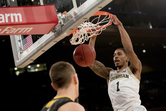 Michigan Guard Charles Matthews (1) Gets to the Basket for a Dunk.