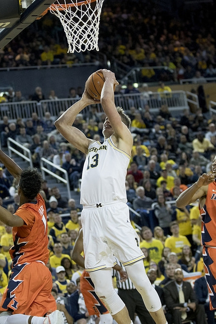 Michigan Forward Moritz Wagner (13) Gets Past 2 Illinois Defenders for the Basket.