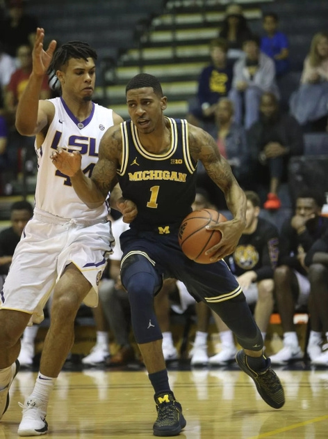 Michigan Guard Charles Matthews (1) Gets Position on the Louisiana State Defender.