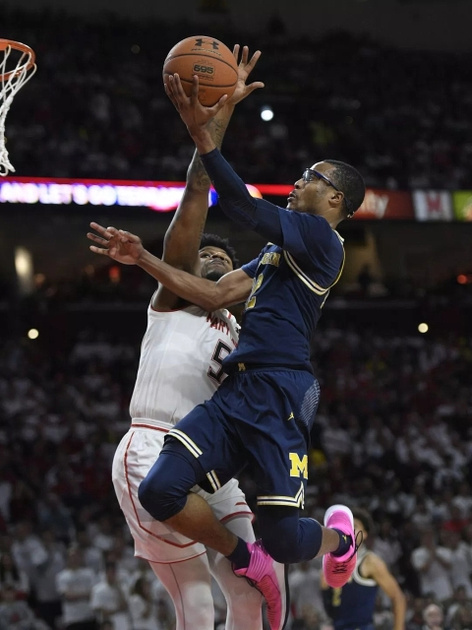 Michigan Guard Muhammad-Ali Abdur-Rahkman (12) Gets by the Maryland Defender for a Lay-up.