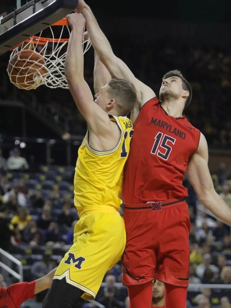Michigan Forward Moritz Wagner (13) Gets by the Maryland Defender and Dunks the Ball.