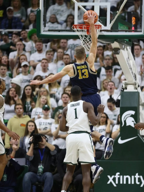 Michigan Forward Moritz Wagner (13) Gets By the Michigan State Defender for a Dunk.