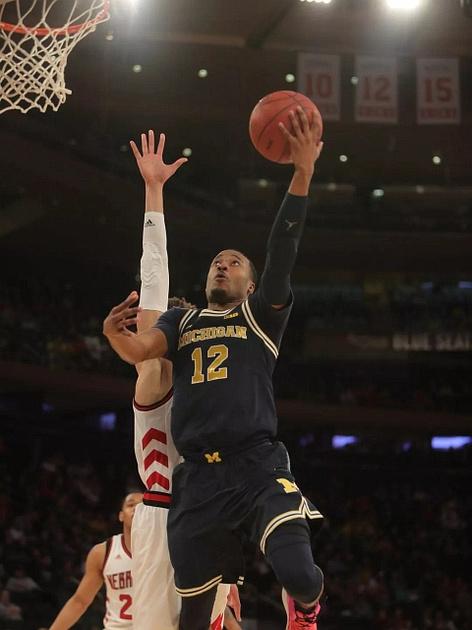 Michigan Guard Muhammad-Ali Abdur-Rahkman (12) Goes to the Basket