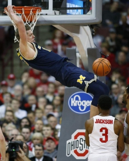 Michigan Forward Moritz Wagner (13) Gets By the Ohio State Defender for the Dunk.