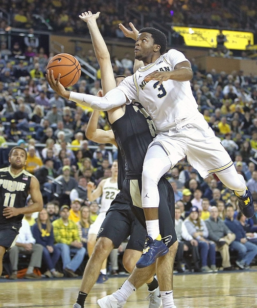 Michigan Guard Zavier Simpson (3) Gets Past the Purdue Defender for a Basket.