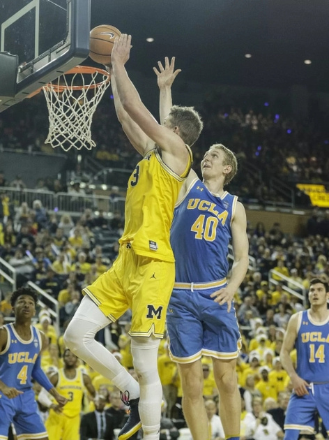 Michigan Forward Moritz Wagner (13) Gets by the UCLA Defender for a Dunk.