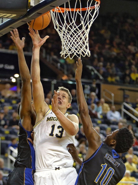 Michigan Forward Moritz Wagner (13) Gets Past Two UC-Riverside Defenders for the Lay-up.