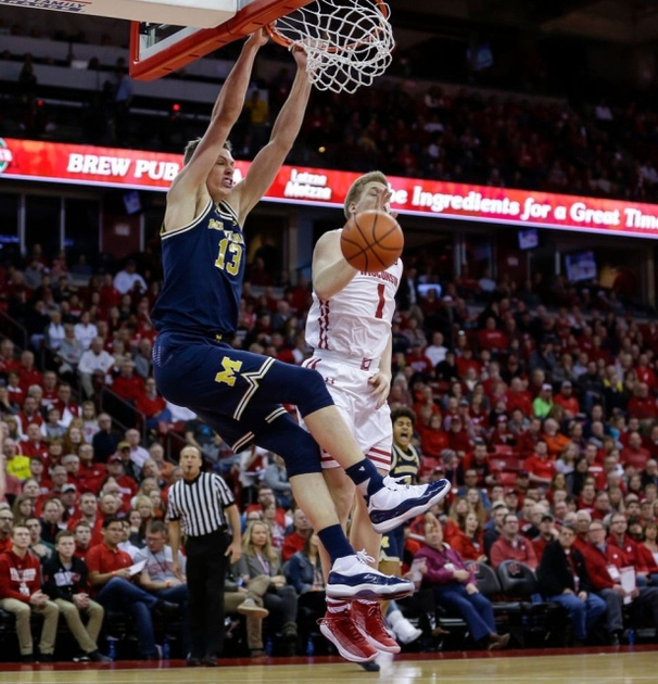 Michigan Forward Moritz Wagner (13) Gets By The Wisconsin Defender for a Dunk.