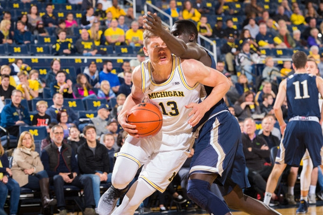 Michigan Forward Moritz Wagner (13) Gets Around a Mount St. Mary's Defender.
