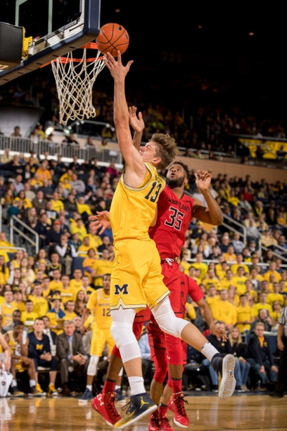Michigan Forward Moritz Wagner (13) Goes to the Basket Past the Maryland Defender.