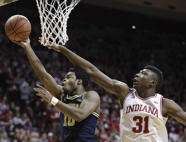 Michigan Guard Derrick Walton Jr. (10) Gets by the Indiana Defender for a Lay-up.