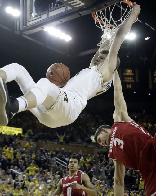 Michigan Forward Moritz Wagner (13) Gets by the Wisconsin Defenders to Make a Dunk.