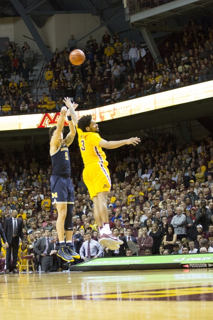 Michigan Forward D.J. Wilson (5) Shoots a 3 Pointer to Extend the Game into Overtime.